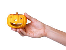 Hand with pumpkin on white Royalty Free Stock Photos