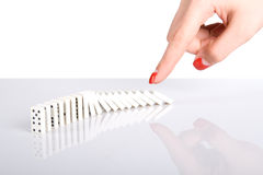 Hand punch the dominoes Royalty Free Stock Photo