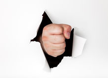 Hand punching hole through paper Royalty Free Stock Image