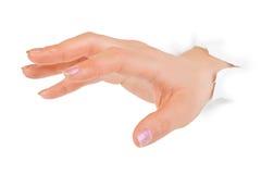 Hand punching through paper Stock Photo