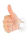 Hand punching thru paper Royalty Free Stock Image
