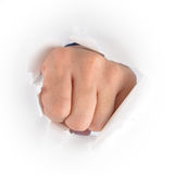 Hand Punching Through White Paper. A fist hand is punching through a white piece of paper. Use it for an anger or impact concept Royalty Free Stock Photo