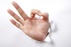 Hand punching white paper and ok sign Royalty Free Stock Photo