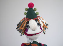 Hand puppet sad clown portrait on white background stock images