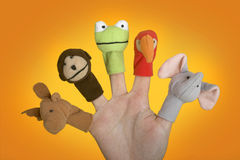 Hand with puppets. Female hand playing with puppets on the fingers royalty free stock photography