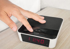 Hand push an alarm clock Stock Photos