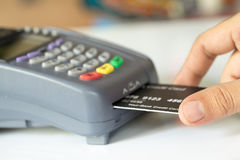Hand Push Credit Card Into A Credit Card Machine Stock Images