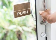 Hand push the door Stock Photos
