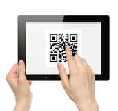 Hand push qr code on tablet pc Royalty Free Stock Photos