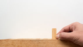 Hand push wooden block Stock Photography
