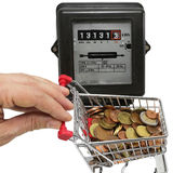 Hand pushes a cart of money to pay the electricity bills Stock Image