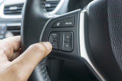 Hand pushes the volume control button Stock Photos