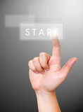 Hand pushing. START button on a touch screen interface Stock Photos