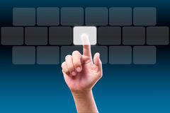 Hand pushing on button. Hand pushing button on touch screen Stock Images