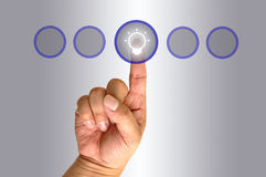 Hand pushing the button Stock Photos