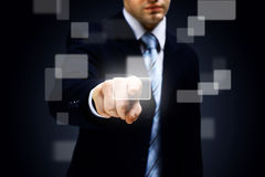 Hand pushing a button Stock Images