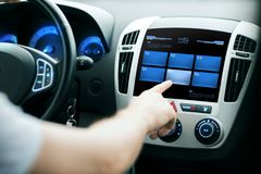 Hand pushing button on car control panel screen Royalty Free Stock Images