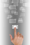 Hand pushing a button email. On a touch screen interface in wide world Royalty Free Stock Image
