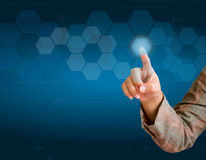 Hand pushing a button on a touch screen. Interface Royalty Free Stock Photos