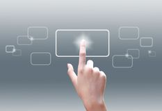 Hand pushing a button on a touch screen Royalty Free Stock Photo