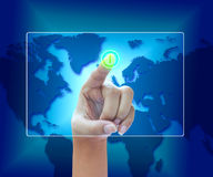 Hand pushing a button on a touch screen Stock Photography