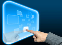 Hand pushing a button on touch screen interface Stock Photos