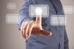 Hand pushing a button on a touch screen interface. Blur man background Stock Photos