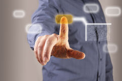 Hand pushing a button on a touch screen interface. Blur man background Royalty Free Stock Photo