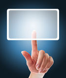 Hand pushing a button on a touch screen interface Royalty Free Stock Photos