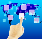 Hand pushing button on a touch screen interface. Finger pushing button on a touch screen interface with world map Stock Photo