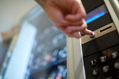 Hand pushing button on vending machine Stock Images