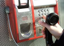 Hand pushing buttons at public phone. Close up hand pushing buttons at public phone Stock Image