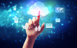 Hand pushing a cloud icon. Cloud computing connectivity concept being pressed in a one persons hand on blue technology background royalty free illustration