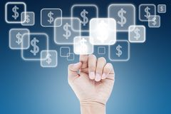 Hand pushing dollar button on touch screen Royalty Free Stock Image