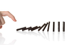 Hand pushing dominoes royalty free stock images