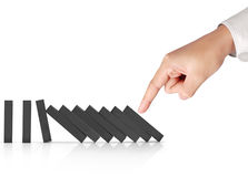 Hand pushing dominoes concept. Hand pushing a dominoes concept Stock Photography