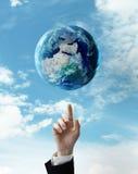 Hand pushing at earth Royalty Free Stock Image