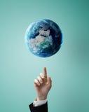 Hand pushing at earth Stock Photos