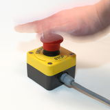 Hand pushing emergency button Stock Image