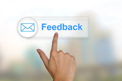 Hand pushing feedback button on a touch screen Royalty Free Stock Images