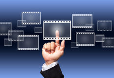 Hand pushing a film button Royalty Free Stock Photos