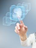 Hand pushing futuristic MRI button Stock Photo