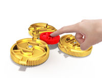 Hand pushing gear to combine with currency symbol gears Stock Photos
