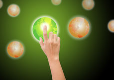 Hand pushing the green world Royalty Free Stock Images