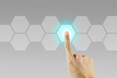 Hand pushing on hexagonal button. Hand pushing one of many hexagonal button to start/stop or choose a choice royalty free stock photography