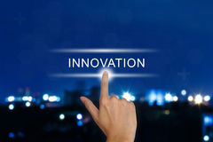 Hand pushing innovation button on touch screen stock photography