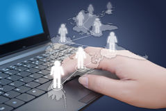 Hand pushing keyboard with social network. Stock Image