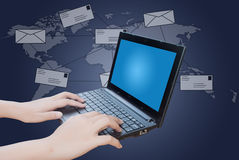 Hand pushing laptop keyboard with social network. Stock Photos