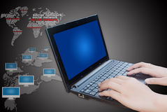 Hand pushing laptop keyboard with social network. Royalty Free Stock Photo
