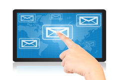 Hand pushing mail on tablet. Stock Images